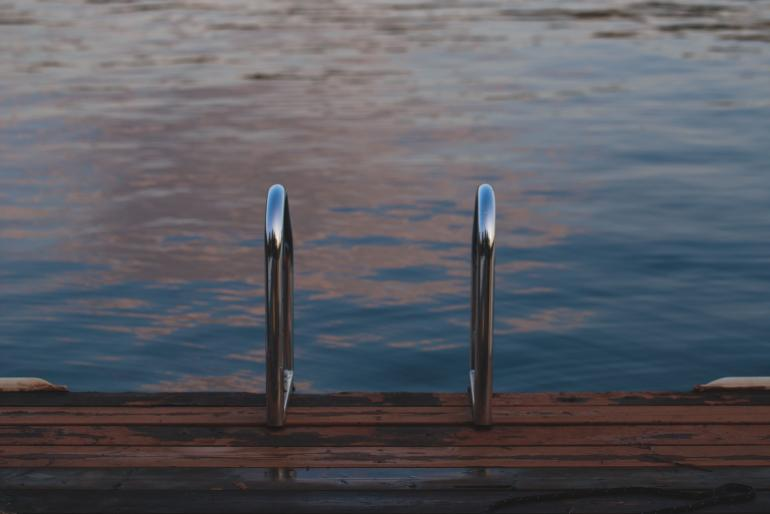 swimming handrails on dock at lake