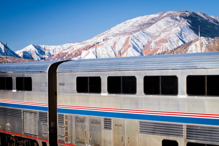 Amtrak against mountain backdrop