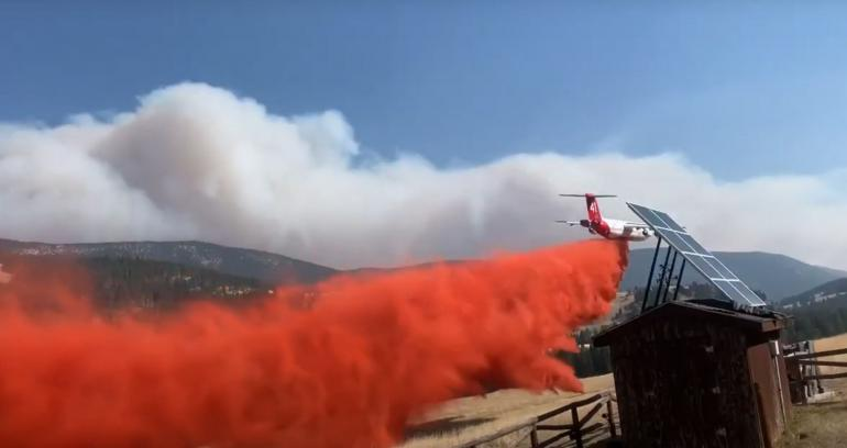 Plane drops flame retardant on Middle Fork