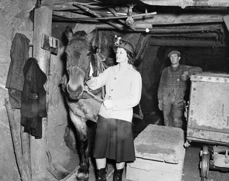 Myrna Loy inspecting the mines