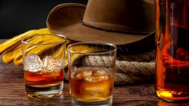 Still-life of cowboy hat with booze