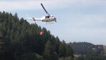 Helicopter approaching to fill bucket