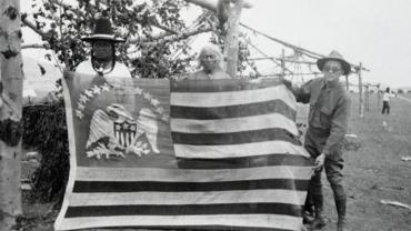 Two Chippewa-Cree Men Posing with 1803 Peace Flag