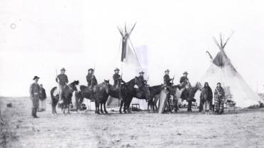 Six Crow Scouts outside Fort Custer