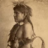 Studio portrait of a young unidentified Crow Indian man circa 1880-1890 (thumbnail)
